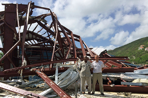 Carnage on the British Virgin Islands following Hurricanes Irma and Harvey. The picture was taken by REIDsteel sales manager Mike Chappell, who was one of the first businessmen to visit the islands following the hurricanes. Mike is pictured right with Hesketh Newton, of Newton Construction, who is REIDsteel's agent in Tortola, BVI.
