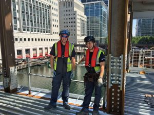 WATER, WATER EVERYWHERE: SMD site operatives Steve Parker, left, and Milliam Dani at the construction site at Canary Wharf